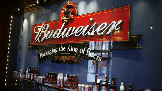 Budweiser beer sits on display under a sign inside the Anheuser-Busch brewery in St. Louis.