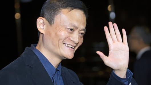 Alibaba Group's founder and executive chairman, Jack Ma, waves as he arrives for a meeting at the Ritz-Carlton hotel in Hong Kong.