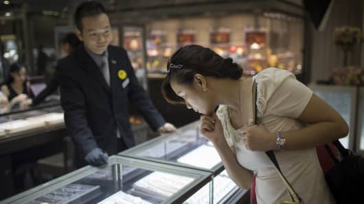 A customer browses jewelry inside a Lukfook Jewellery store, operated by Luk Fook Holdings International Ltd., in Macau, China, on Tuesday, Aug. 26, 2014.