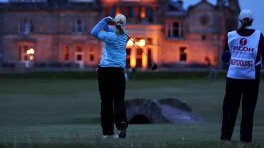 File photo: Anna Nordqvist of Sweden drives at the 18th hole in the dark lit by the clubhouse of the Royal and Ancient Golf Club of St Andrews during the second round of the 2007 Ricoh Womens British Open Championship.