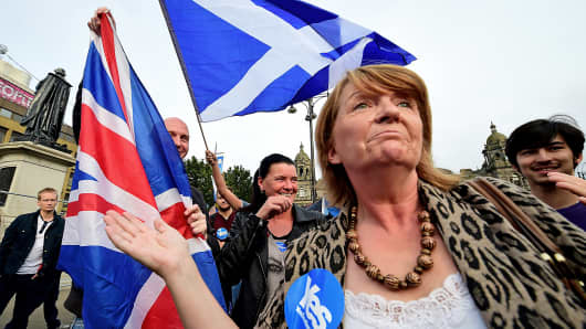 A Scottish independence supporters gather before polling stations close in the Scottish independence referendum, Sept. 18, 2014, in Glasgow, Scotland.