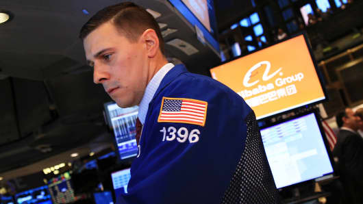 Trader on the floor of the New York Stock Exchange during Alibaba IPO, September 19, 2014.