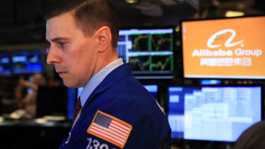 Trader on the floor of the New York Stock Exchange during Alibaba IPO, September 19, 2014