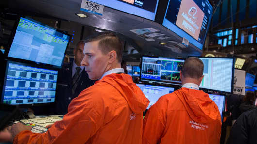 Traders on the floor of the New York Stock Exchange on the day of Alibaba's initial public offering.