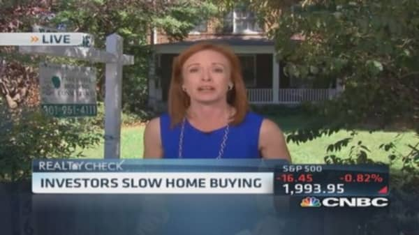 Investors slow home buying