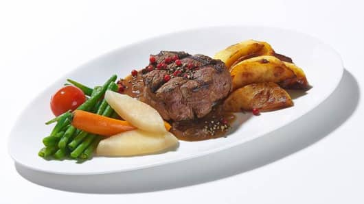 Beef filet steak with caramelized onion sauce is one of the meals on offer to fans of Lufthansa's in-flight food.