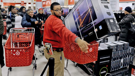 Employee Justin Jones calls for another TV as the big screen TV's sell fast at a Target store in Washington, Nov. 28, 2013.