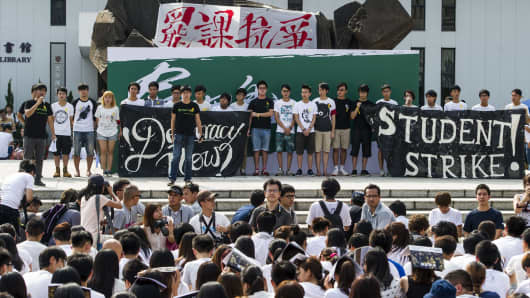 Students gather during a strike as a pro-democracy activist speaks at the Chinese University of Hong Kong on September 22, 2014.