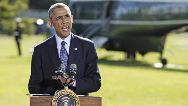 President Barack Obama speaks about airstrikes against militants in Syria, Sept. 23, 2014, on the South Lawn of the White House in Washington.