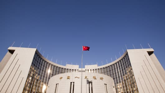 The Chinese flag flies outside the People's Bank of China in Beijing, China.