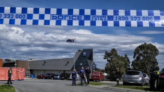 Forensic police are seen at the scene where a man as shot dead after stabbing two counter terrorism officers in the suburb of Endeavour Hills on September 24, 2014 in Melbourne, Australia.