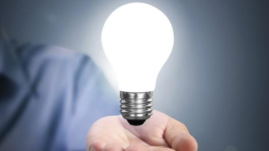 Lightbulb floating over hand