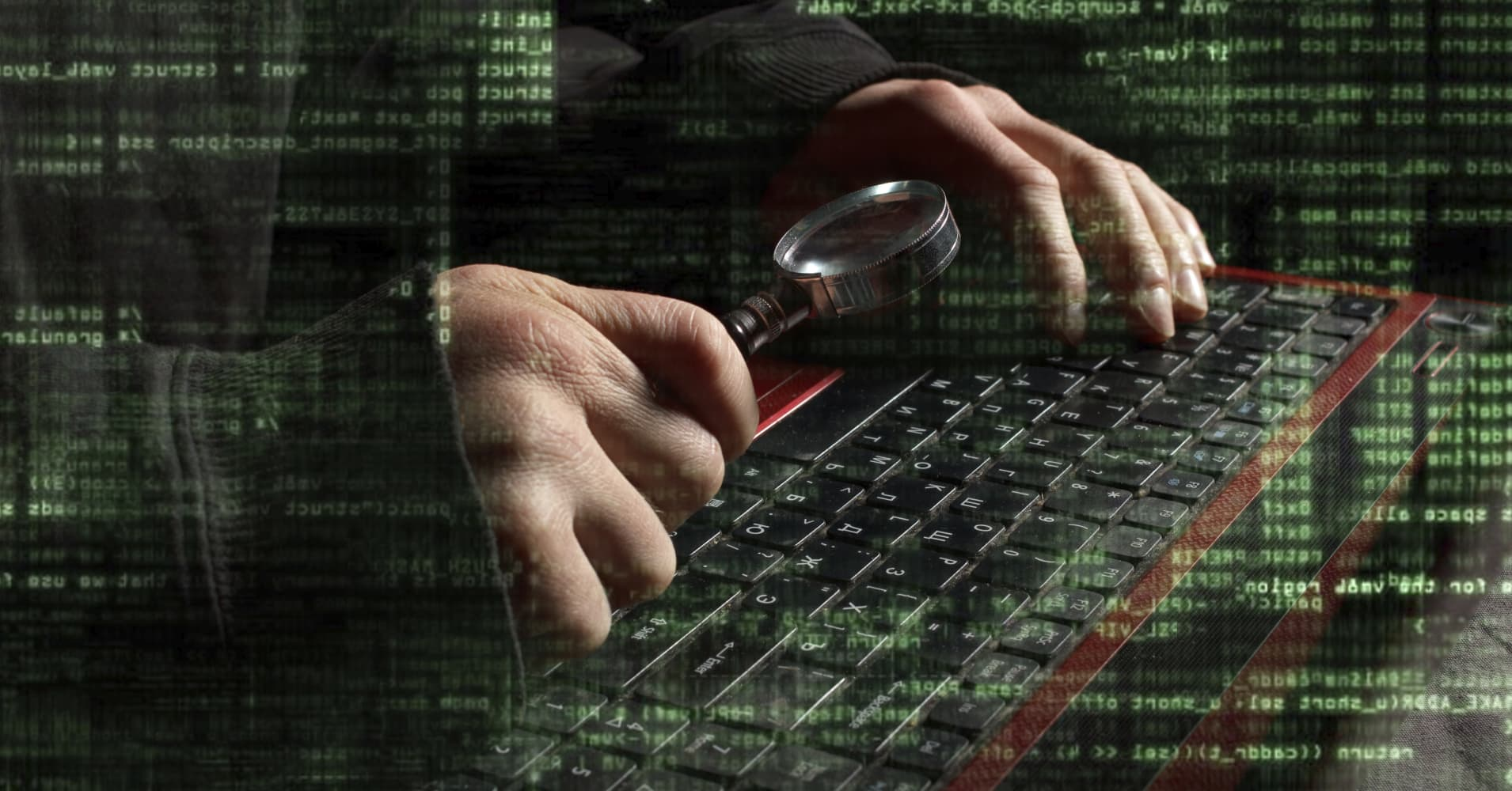 Russian Hackers Hunt Hi Tech Secrets Exploiting Us Weakness Man Hand Holding A Magnifying Glass Above Circuit Board