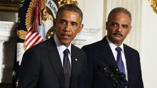 President Barack Obama stands with Attorney General Eric H. Holder Jr. who announced his resignation today, September 25, 2014 in Washington.