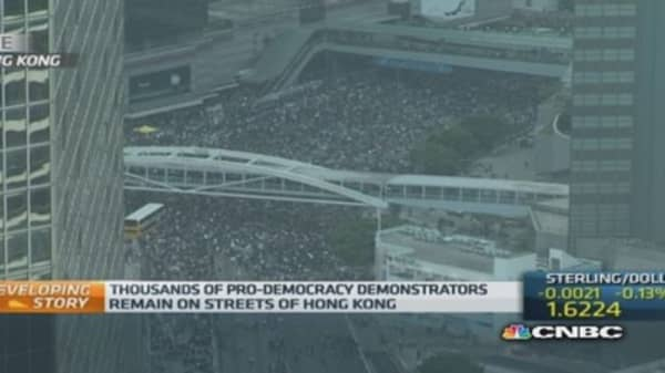 Protestors pour back onto Hong Kong's streets