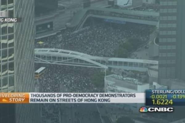 Protestors pour back onto Hong Kong's streets