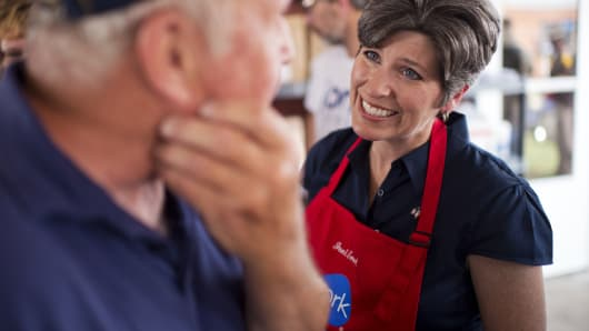 Joni Ernst, Iowa Republican Senate candidate, talks with a voter in the Pork Tent at the 2014 Iowa State Fair in Des Moines, Aug. 8, 2014.