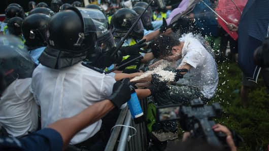 Protesters clash with riot police on September 27, 2014 in Hong Kong.
