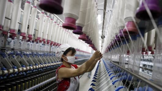 A woman working in a textile factory in Huaibei, China.