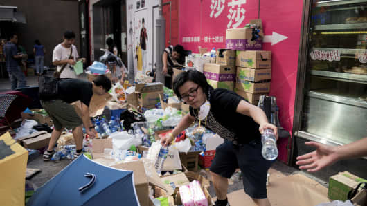 People pass out food and drink at a pro-democracy protest on Nathan Road, a major route through the heart of the Kowloon district of Hong Kong, on September 29, 2014.