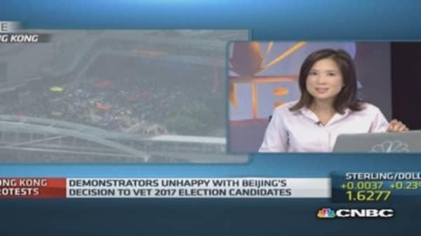 Hong Kong protestors defiant but respectful