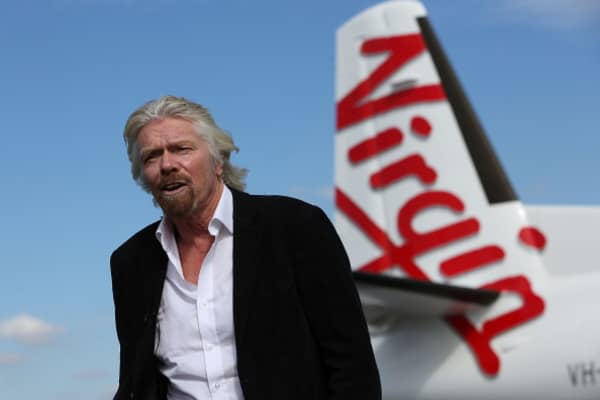 Richard Branson talks to the media at Perth Airport in May 2013 in Perth, Australia.