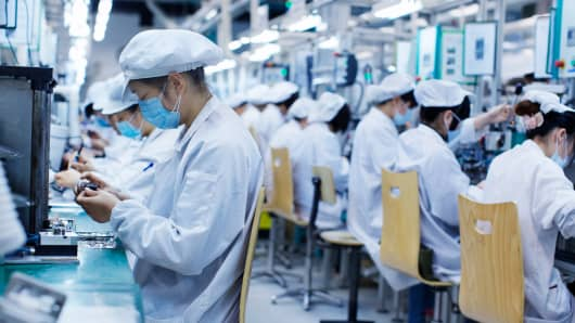 Group of workers at a small parts manufacturing factory in China.