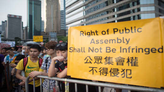 Pro-democracy demonstrators gather near a ceremony marking China's 65th National Day in Hong Kong on October 1, 2014.