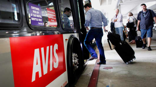 A passenger boards an Avis shuttle bus at the Los Angeles International Airport.