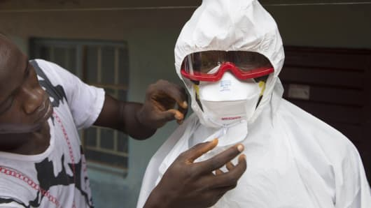 People wearing protective clothing for the Ebola virus, in Freetown, Sierra Leone, September 28, 2014.