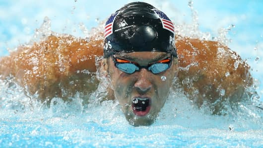 Michael Phelps swims the Men's 200m IM Final of the 2014 Pan Pacific Championships on August 24, 2014 in Gold Coast, Australia.