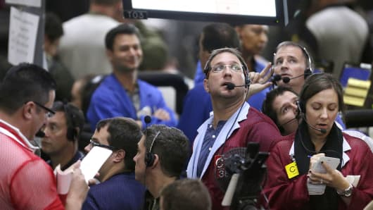 In this Sept. 24, 2014 photo, traders work in the ten-year bond pit on the floor of the CME Group in Chicago.