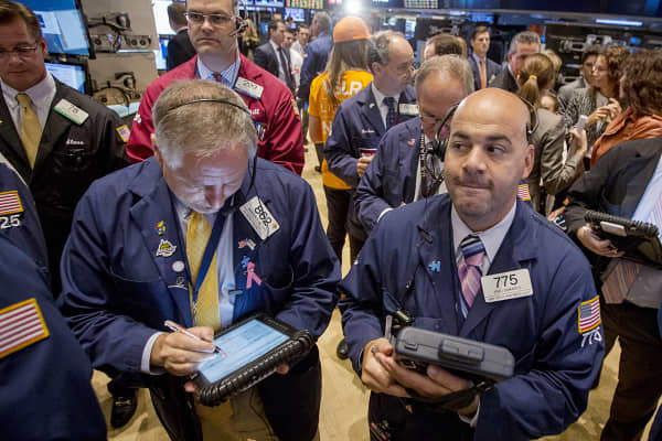Traders work on the floor of the New York Stock Exchange, Oct. 1, 2014.