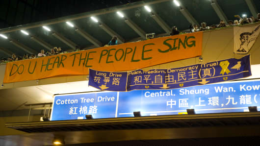 A banner reads 'Do you hear the people sing', as part of a pro-democracy sit-in known as 'Occupy Central' in Hong Kong.