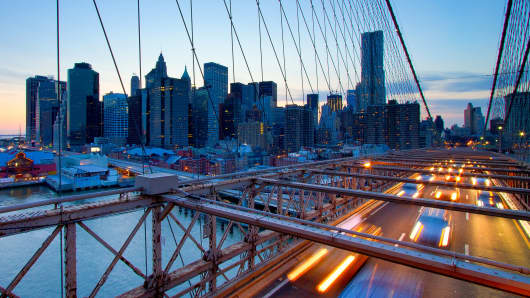 The Brooklyn Bridge and the skyline of lower Manhattan, New York.