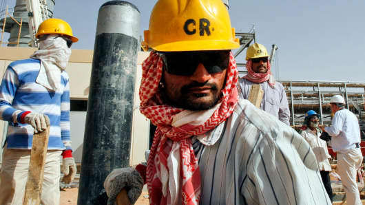 Workers at an oil facility near Riyadh, Saudi Arabia.