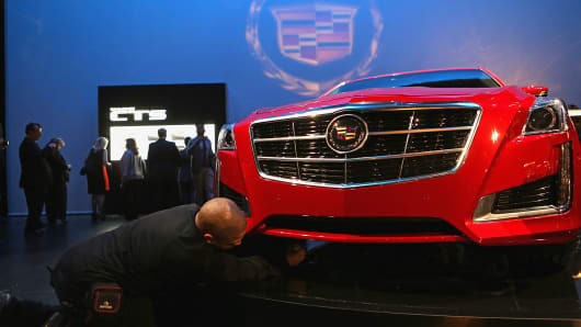 A 2014 Cadillac CTS sits on display during an unveiling event in New York, March 26, 2013.