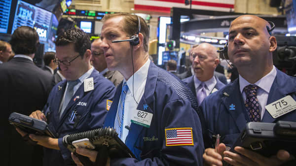 Traders work on the floor of the New York Stock Exchange, Oct. 2, 2014.