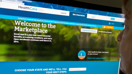 A woman looks at the HealthCare.gov insurance marketplace site in Washington.