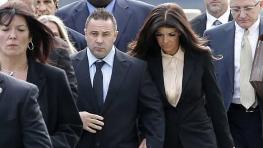 "Teresa and Giuseppe ""Joe"" Giudice hold hands as they arrive at U.S. federal court in Newark, New Jersey, Oct. 2, 2014."