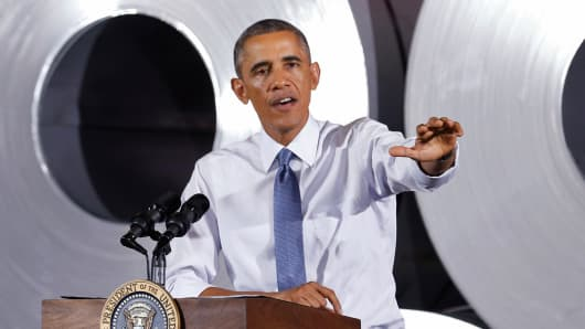 President Barack Obama speaks about jobs, in front of steel coils at the Millennium Steel Service, as part of Manufacturing Day in Princeton, Ind., Oct. 3, 2014.