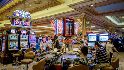 Chinese gamblers at a casino located inside the Venetian hotel in Macau, China.