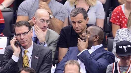 NBA Commissioner Adam Silver, Chairman and CEO of The Walt Disney Bob Company Bob Iger and Earvin 'Magic' Johnson attend an NBA playoff game between the Oklahoma City Thunder and the Los Angeles Clippers at Staples Center on May 11, 2014 in Los Angeles, California.