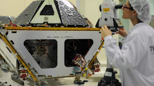 A technician works on the assembly line of second-generation Globalstar satellites.