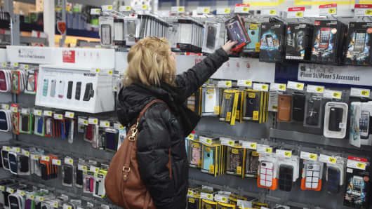 A customer looks at Apple Inc. iPhone accessories at a Best Buy Co. store in Northbrook, Illinois.