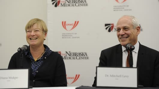 Diana Mukpo and Dr. Mitchell Levy speak at a news conference at the Nebraska Medical Center in Omaha, Oct. 6, 2014.