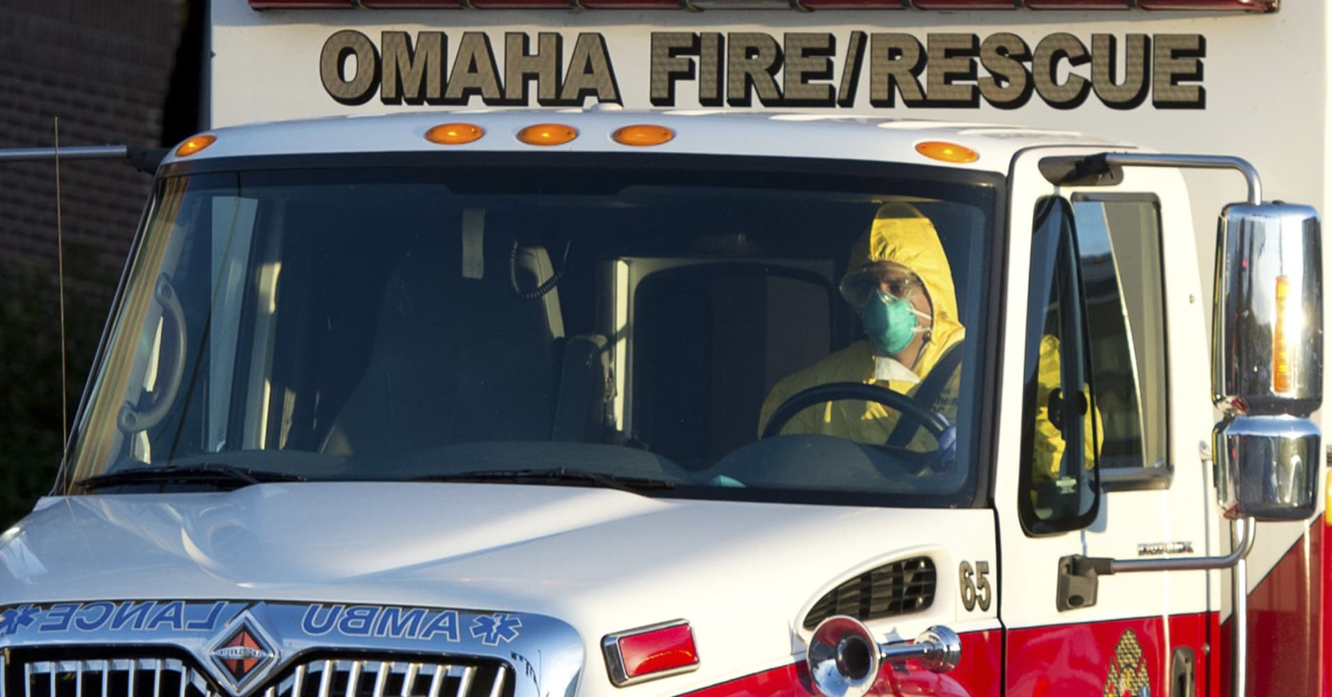 An ambulance transports Ebola victim Ashoka Mukpo to the Nebraska Medical Center in Omaha, Oct. 6, 2014.