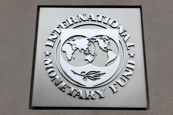 The International Monetary Fund (IMF) logo is seen at the IMF headquarters building in Washington.