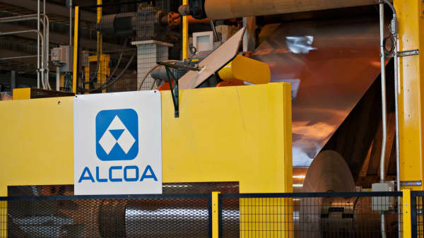 Rolled aluminum is fed into a machine on the auto treatment line at the Alcoa Inc. Davenport Works aluminum facility in Riverdale, Iowa.