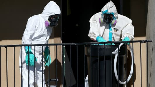 The Cleaning Guys hazmat cleanup company are seen here as they sanitize the apartment where Ebola patient Thomas Eric Duncan was staying before being admitted to a hospital in Dallas.